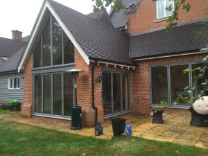 Removed brickwork and installed bespoke colour bi-folding doors and matching apex frame